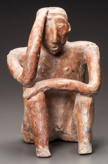 Pre-Columbian:Ceramics, A LARGE COLIMA SEATED FIGURE. c. 200 BC - 200 AD...