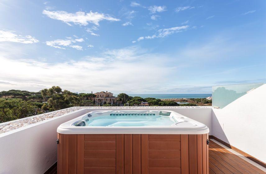 Salt Vs Chlorine Hot Tubs Hot Tub Outdoor Living Outdoor Decor