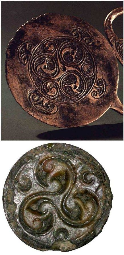 Top one is   Detail of decoration on a Celtic bronze dress fastener from Ireland (6th c. AD). Executed in the Ultimate La Têne style, the arms of the triskele decoration are spirally coiled and end in  birds heads