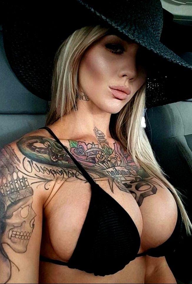 Busty Tattooed Blonde Woman Shows Big Ass