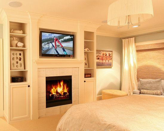 Creamy white and blue, but with soft lighting, fireplace, built-ins ...