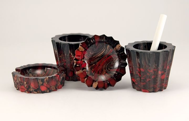 """Beautiful and rare set of Italian art glass smoking accessories  Circa 1940s.  Credited to glass maker V. Nason, distributed by Weil.  Impressed 'Italy' on the bases.  Click to learn more about Italian Art Glass. Made with earthy red and brown glass with glittery copper adventurine. Set includes two hand-held size ashtrays and two accessory/smoke holders.  Ashtrays measure 2½"""" round, 1"""" tall - perfect for those little smokes.  Smoke, matchstick, paraphernalia holders measure 2"""" tall."""