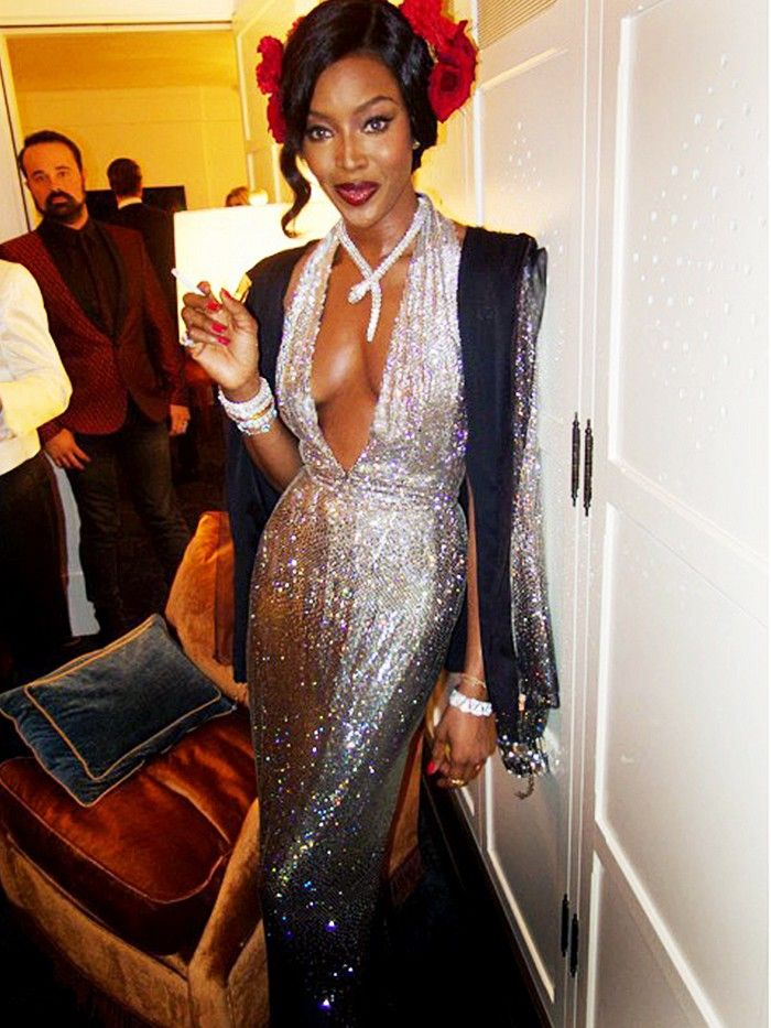 Naomi Campbell is a vision in this plunging neckline shimmery gown via mariotestino