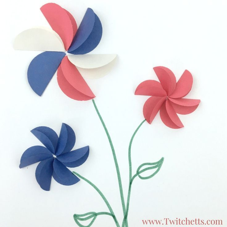How to make giant construction paper flowers with kids #constructionpaperflowers Create these amazing construction paper flowers in red white and blue.  They are perfect patriotic crafts for kids. #constructionpaperflowers