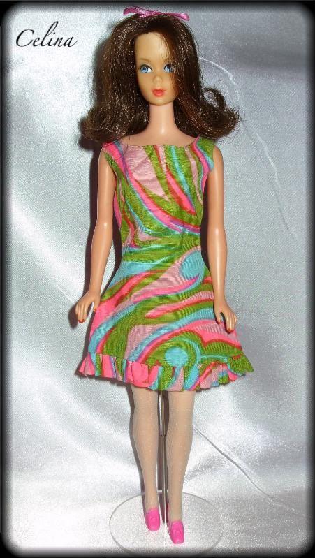 Mod Twist N Turn Brunette Marlo Flip Barbie modeling Swirly Cue outfit.