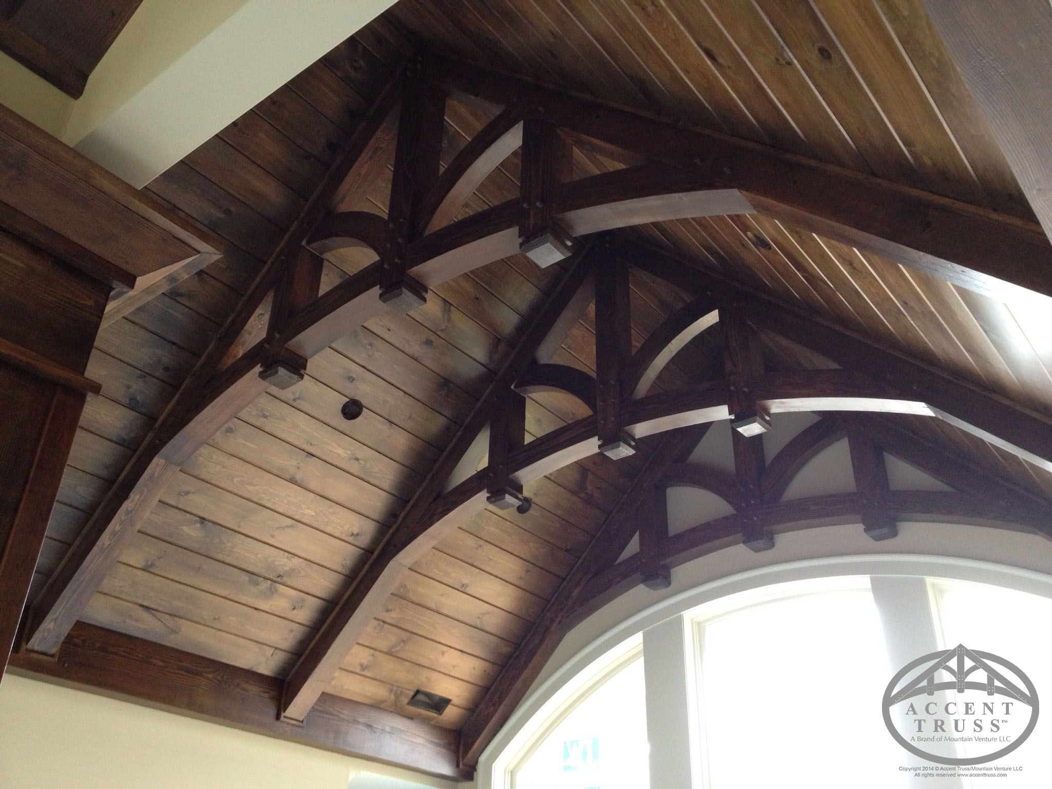 Dark stain on heavy trusses and a wood paneled ceiling trusses dark stain on heavy trusses and a wood paneled ceiling malvernweather Choice Image