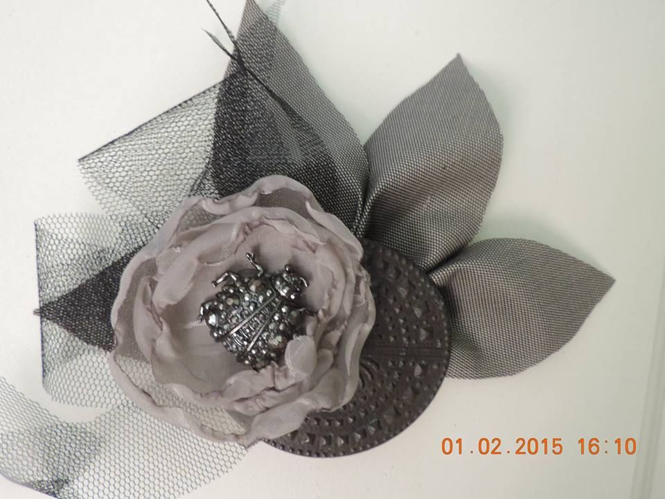 Hair piece.. Hand crafted flowers ..black netting and bling beetle