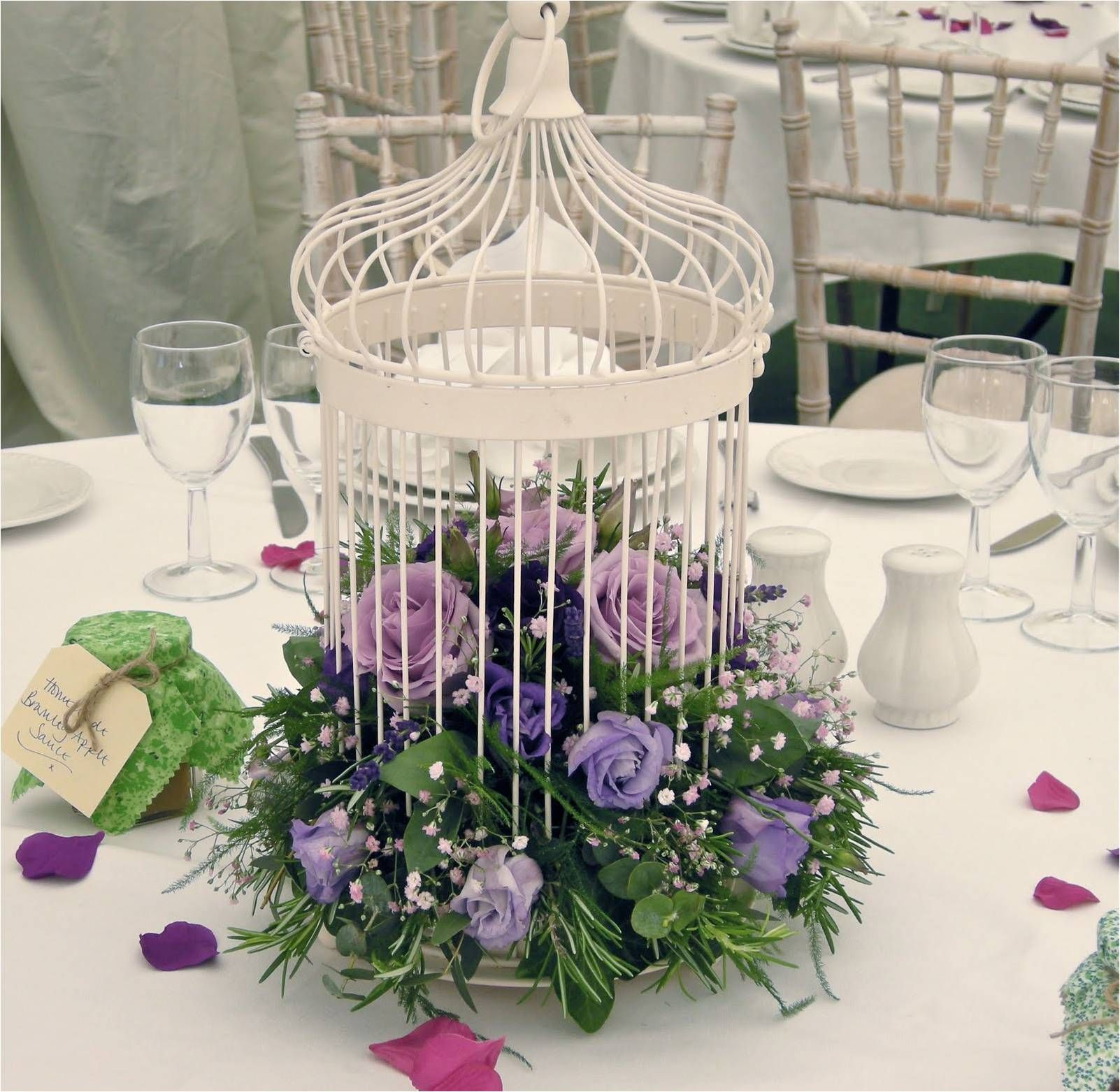 Birdcages Decorated In Flowers With The Colour Accent You Have
