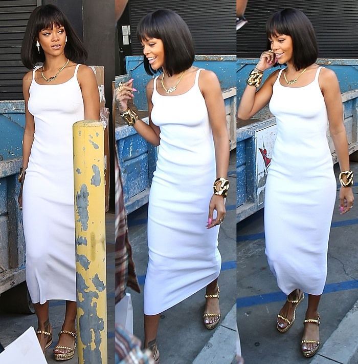 30d582c4105 Rihanna trying to escape the paparazzi in a skintight tea-length tank dress  by exiting the back entrance of Moncler in Beverly Hills on February 17