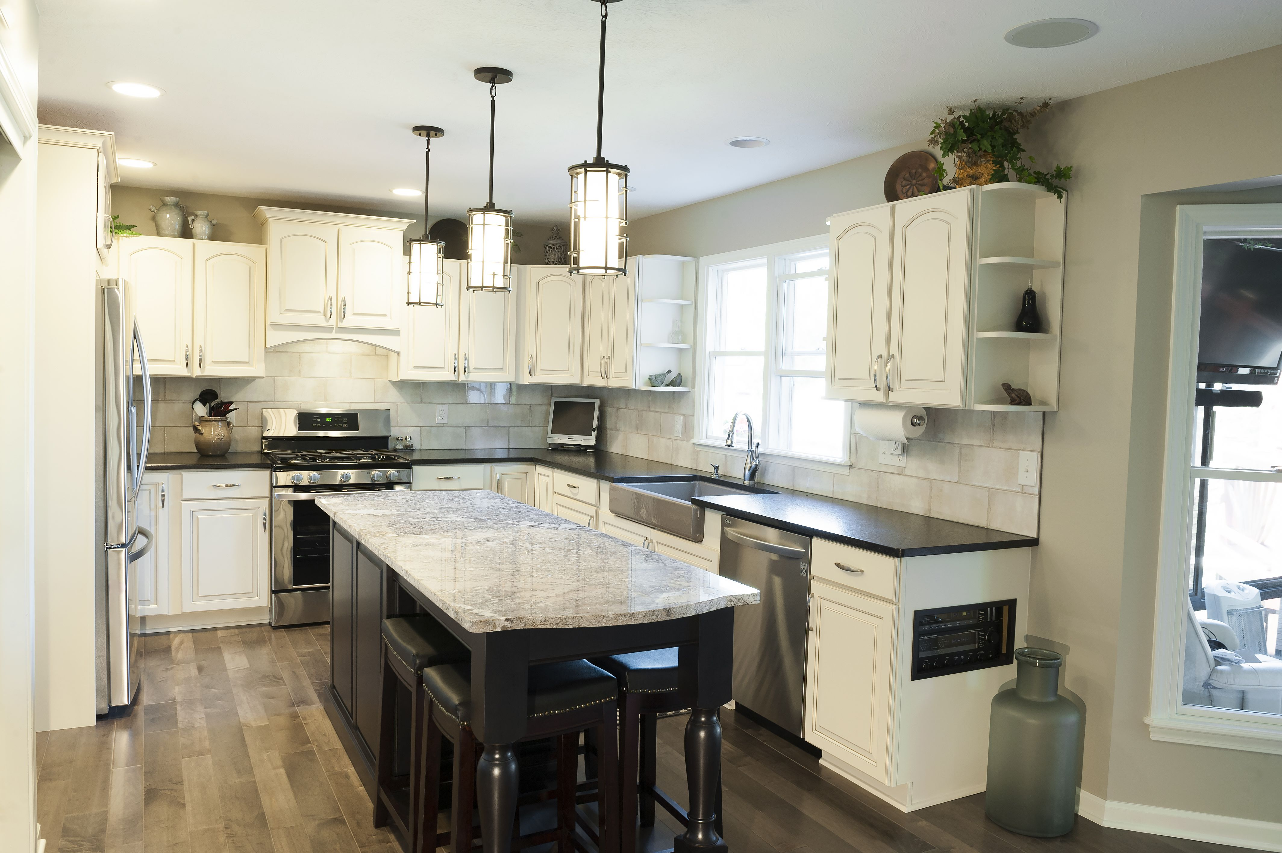 how to add a kitchen island painting existing cabinets and adding an island made a dramatic difference to this kitchen 8687