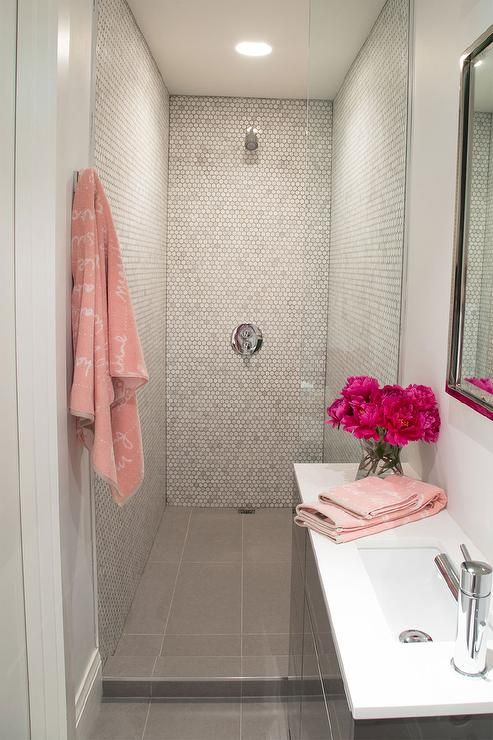 Pink And Gray Bathroom Features A Gray Lacquered Vanity Topped