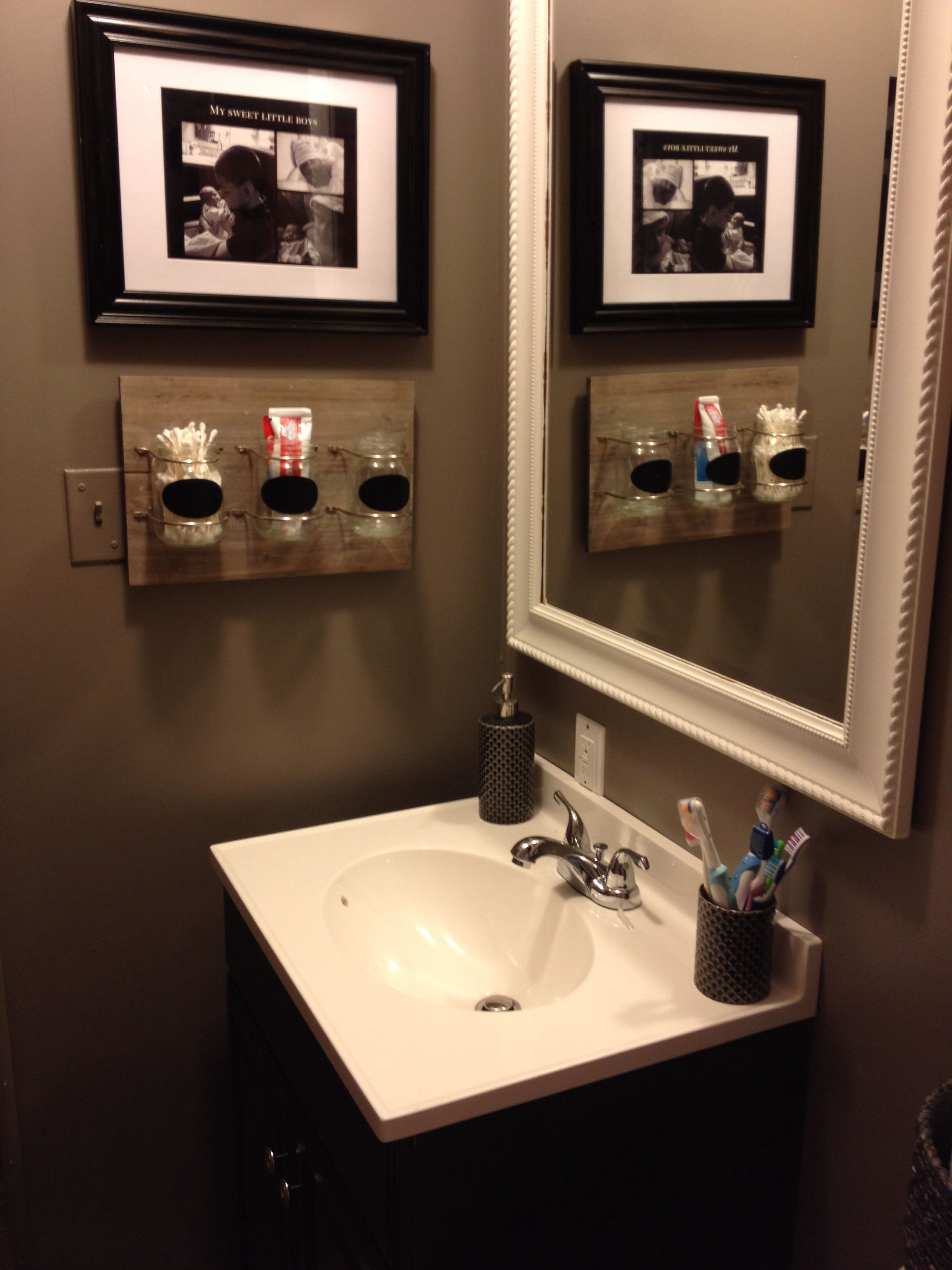 Bathroom revamp. Wall color is fashion grey by behr. Paint and primer in one.