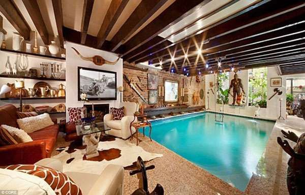 How awesome is it to have a pool in the middle of your man cave!