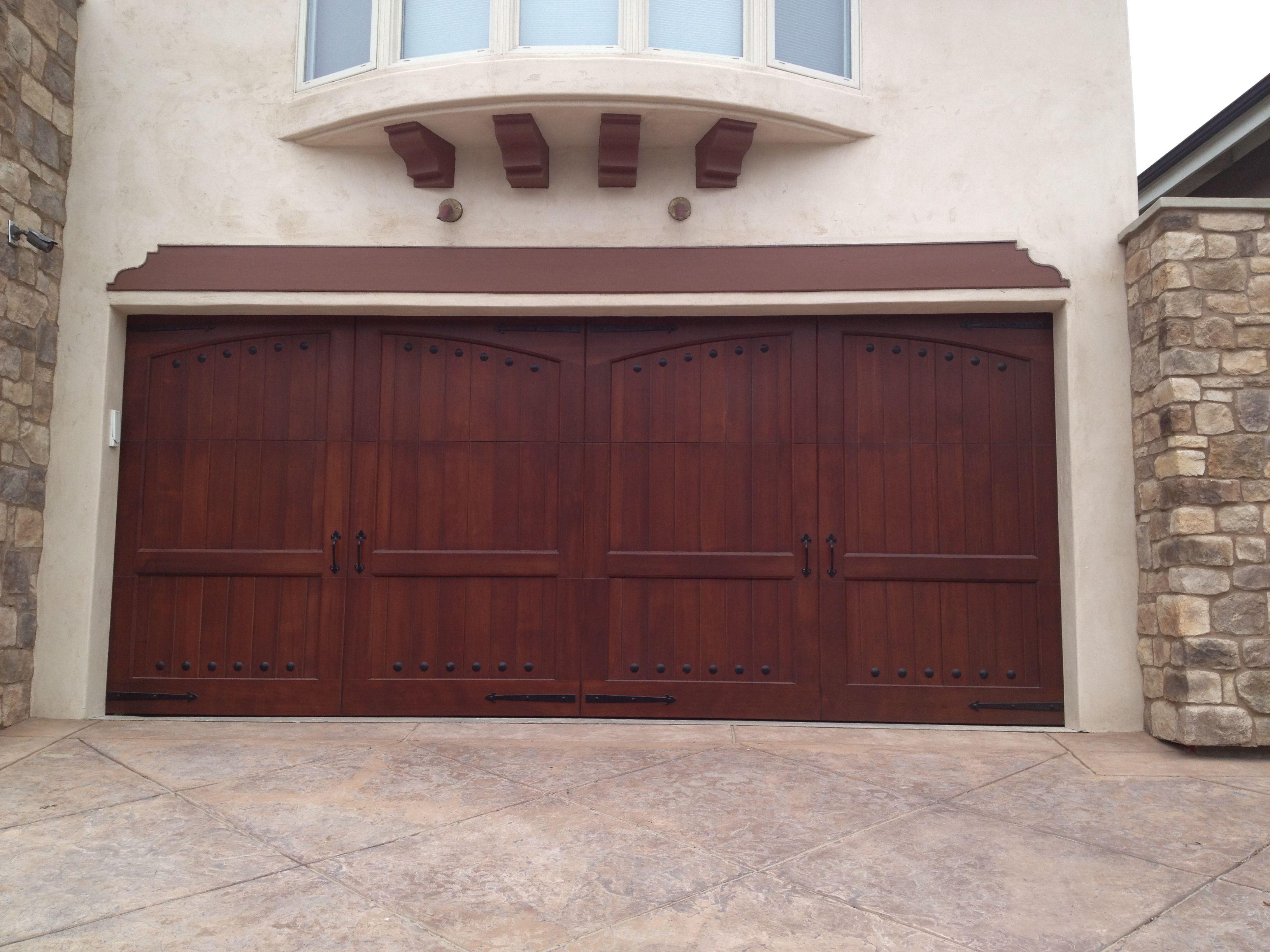 Beautiful Carriage House Non-Traditional Woodlike Custom Garage Door.  Los Angeles, CA Photo Credit: Agi Dyer