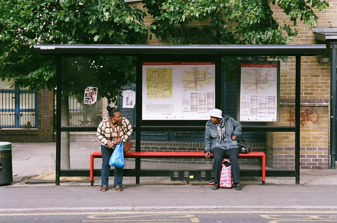 Family Waiting For Transit On A City Bus Stop With Images Bus