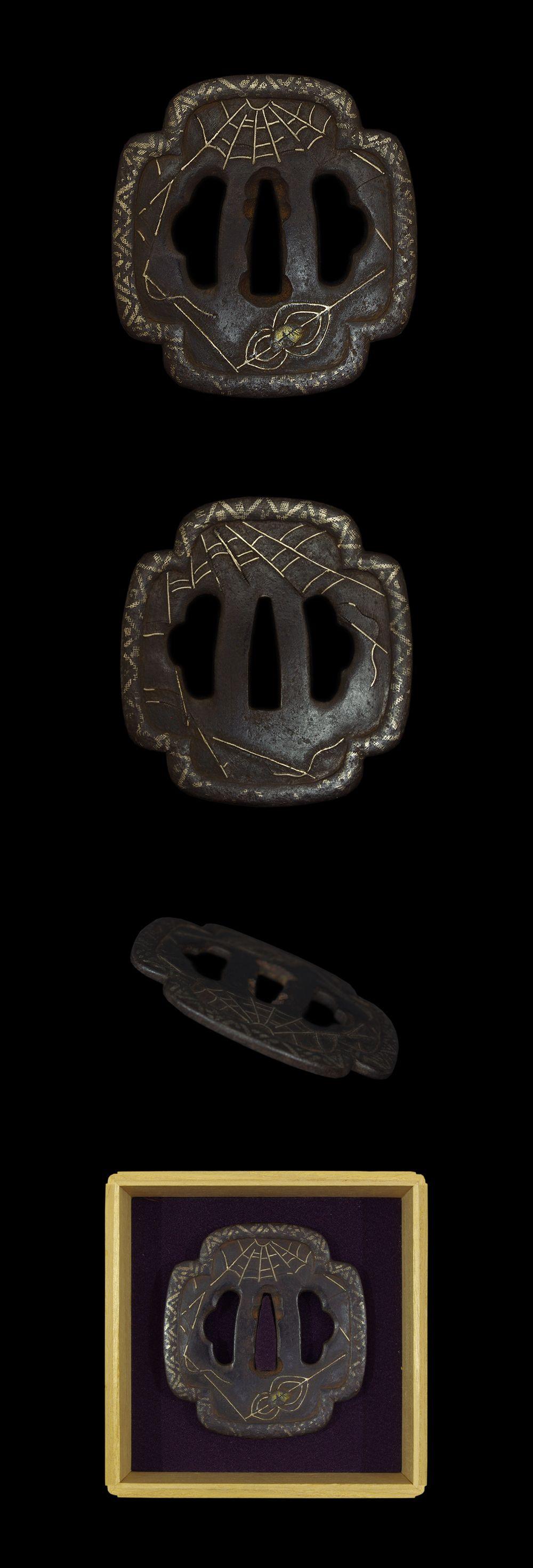 Kumo (spider) zu Tsuba. On the Tatemaru shaped iron Tsuba, Spider and spider web are engraved with gold and silver zougan. The mimi is Sukinokoshi-Dote mimi style with spot nunome zougan
