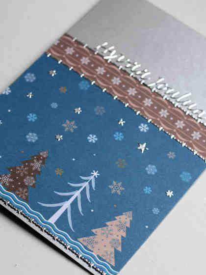 Talvinen metsä joulukorttiin hopeisilla tarroilla