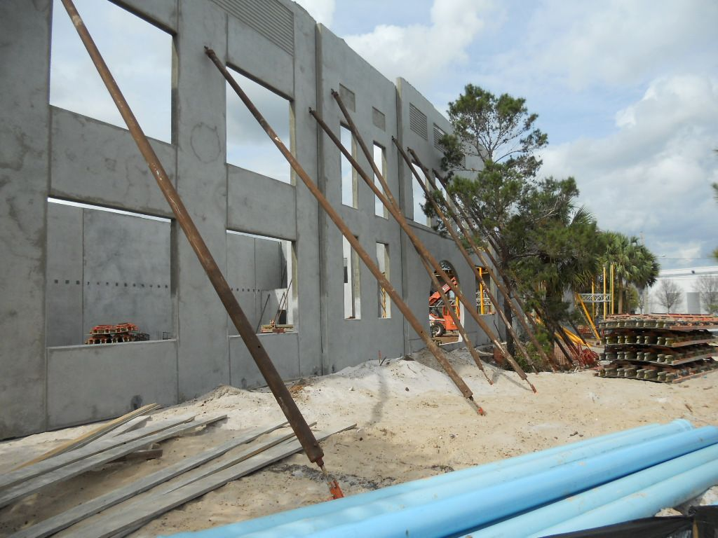 Concrete tilt up wall panel under construction for Precast concrete basement walls cost