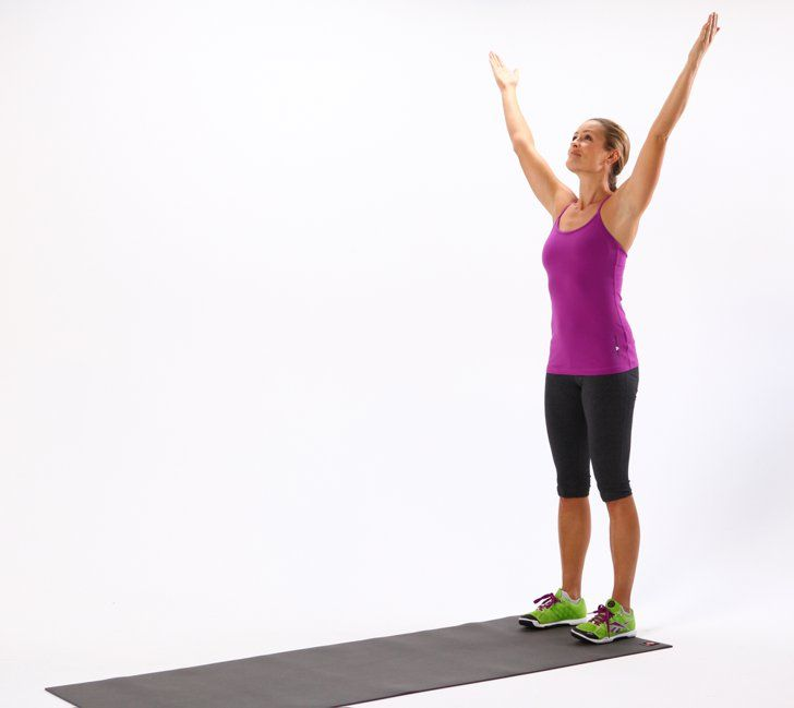 Pin for Later: 1 Move to Prep Your Entire Body For Working Out Reach Up Stand at the back of your mat, and circle your arms out to the sides to reach toward the ceiling. Look up, and feel your chest opening up.