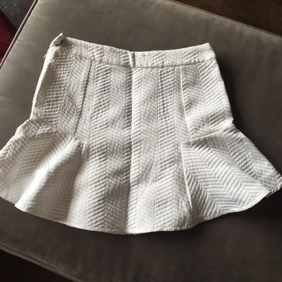 White textured ruffle mini skirt Like new. 15 1/2 inches in length. 14 1/2 inches across waist. From smoke free pet free home AKIRA Skirts Mini