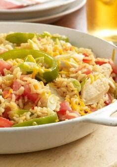 Cheddar-Chicken & Rice Skillet — Here's a family favorite just waiting to be discovered: a glorious 30-minute chicken and rice skillet recipe, made with cheddar, peppers and tomatoes.