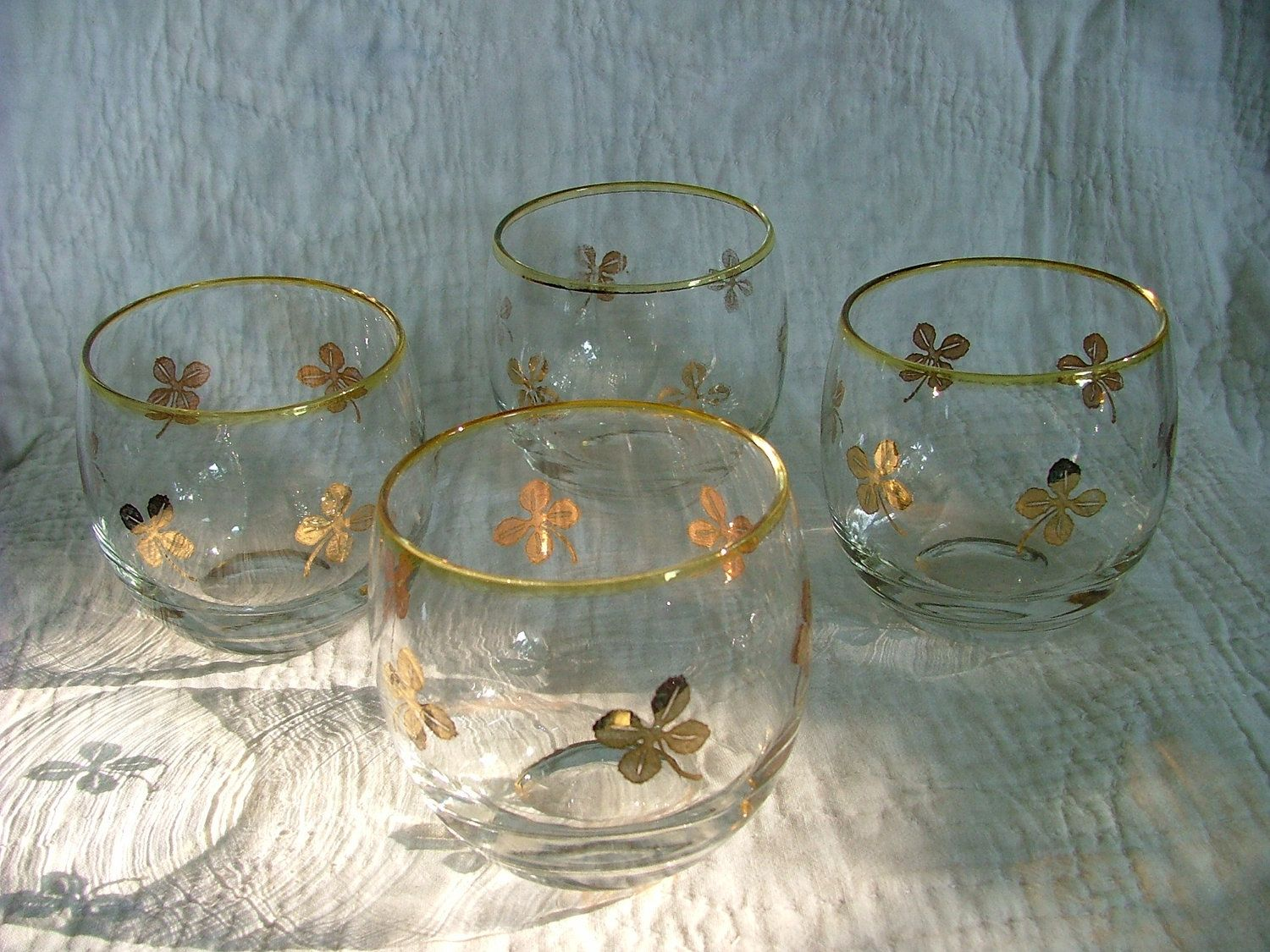Four Large Vintage Roly Poly Lucky  Clover Mad Men Style Glasses. $15.00, via Etsy.
