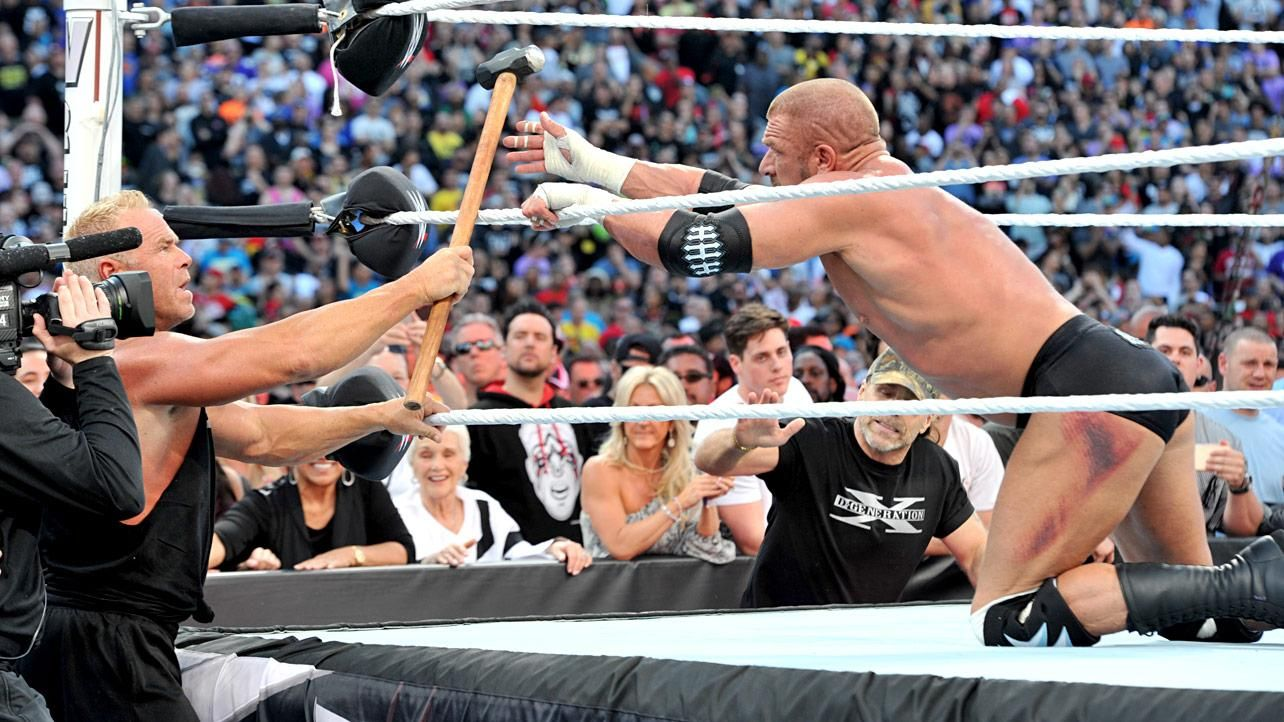 Billy Gunn gives the sledgehammer back to Triple H ...