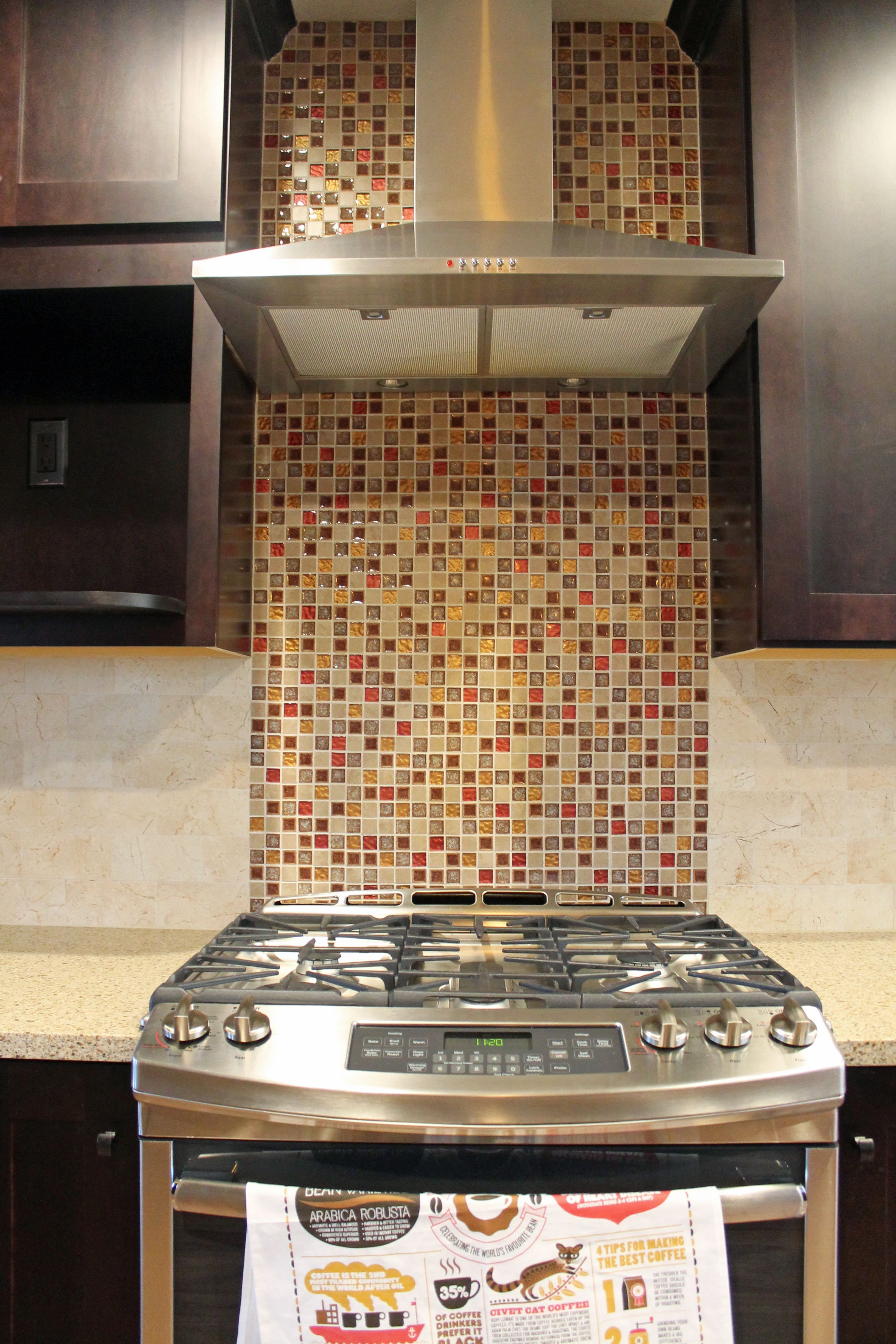 kitchen mosaic tile backsplash with stainless steel vent hood and rh pinterest com stove top tile backsplash backsplash ideas behind stove top