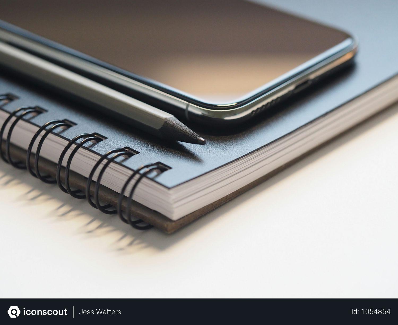 Free Closeup Photo Of Black Smartphone Near Black And Grey