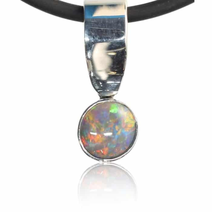 A solid lightning ridge opal with strong red orange colour with one small white cloud at the 7 o'clock position, this does not detract from the overall look as its quite small. A beautiful pendant.