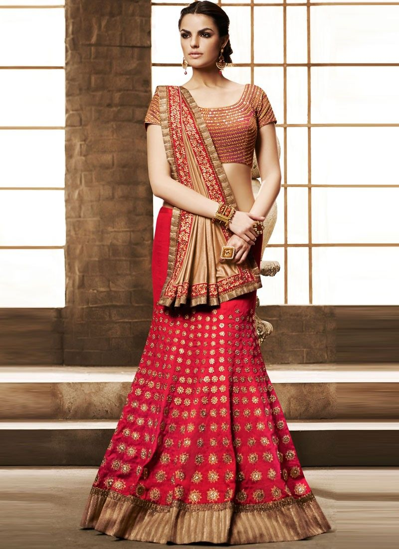 Make a stunning style statement with this hot pink bhaglpuri silk lehenga saree. This saree is beautified with beautiful embroidery work and patch border work gives charming look.