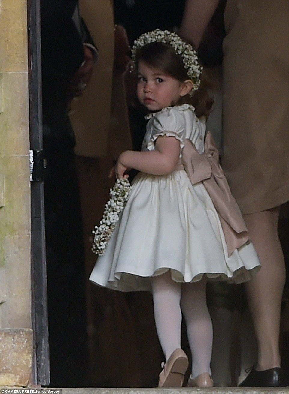 Charlotte looked a little apprehensive as she made her way into the church on the arm of h...