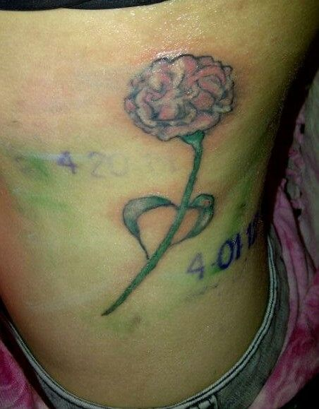7ee9c6dc1d0cd 3rd tattoo on my side for my grandmother who passed away April of this  year. She loved carnations and the color pink