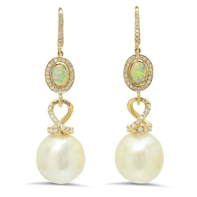 Vibrant Australian opals make an exotic pairing with 16mm South Sea pearls in these elegant earrings. Accented with pavé diamonds and set in 18-karat yellow gold, each impactful drop measures 5.5 centimeters long.