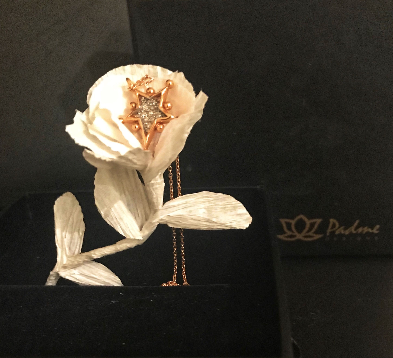 Window display ideas for jewelry  paper flower for jewellery display  window display  pinterest