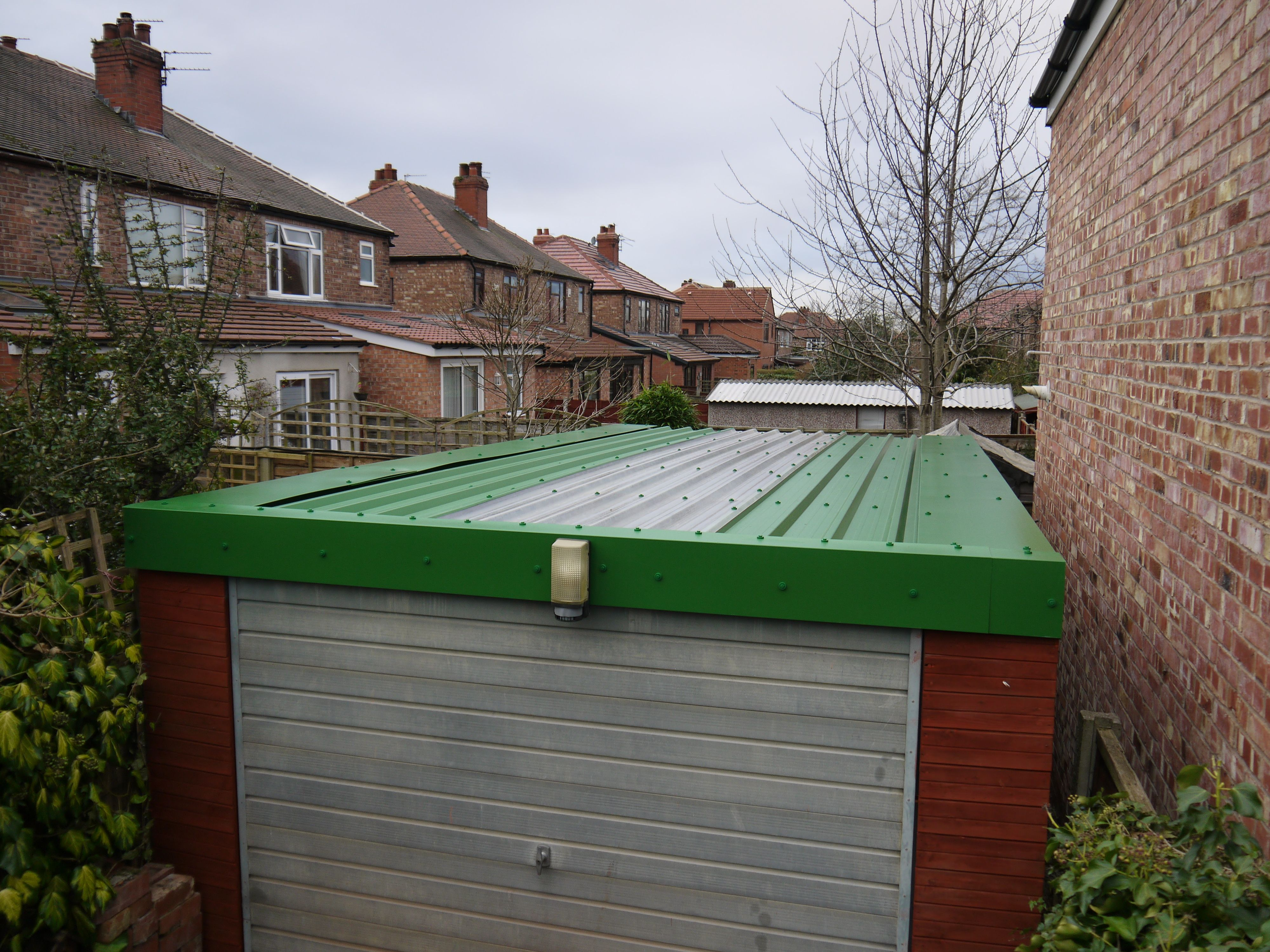 Best A New Roof For This Cunningham Concrete Sectional Garage 400 x 300