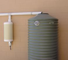 Wall mounted first flush rain barrel diverter. Collects the first flush of rain water that typically contains most of the pollutants, dead bugs, bird dropping, debris from roof and shingles, etc..
