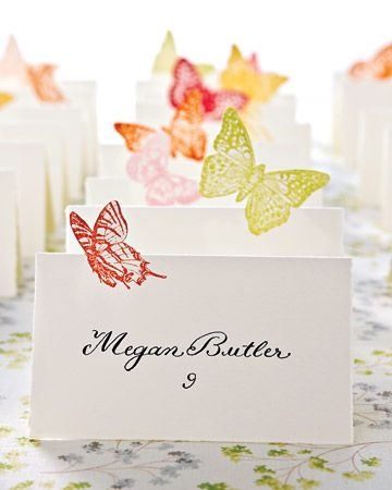 The half-silhouettes of these cards make the butterflies seem to flutter over the table.