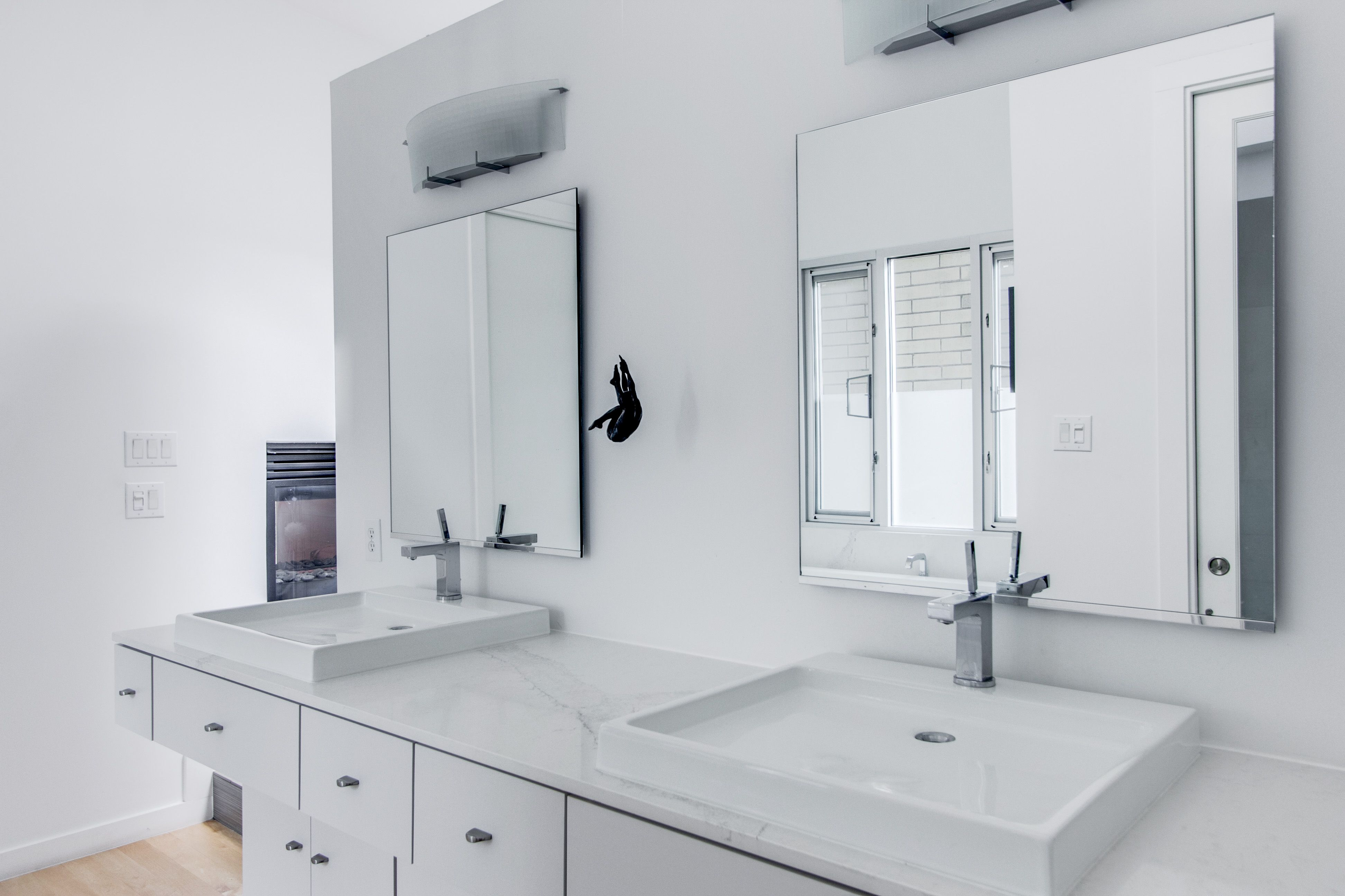 To give this bathroom a clean updated look, we refaced the cabinets ...