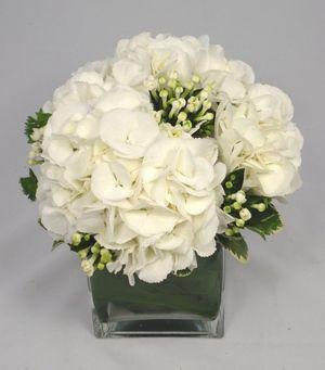 White Wedding Flowers Arrangements Beautiful Bouvardia designed by Pollen Floristry at My Wedding Flower Ideas Magazine