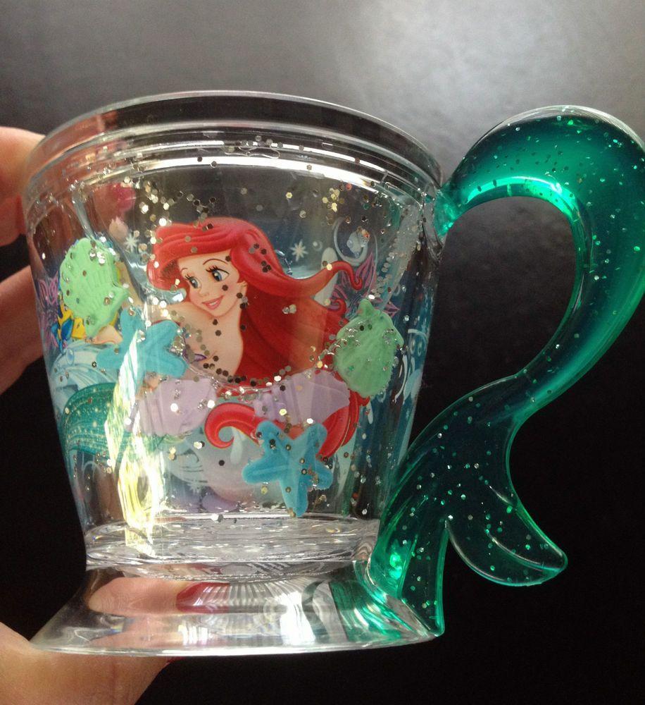 Totally cute Ariel Little Mermaid Kids Cup. Sturdy Glitter Fin Handle. Glitter and Star Fish swim around inside as you use the cup. FUN! Completely sold out at the Disney Store but available here!