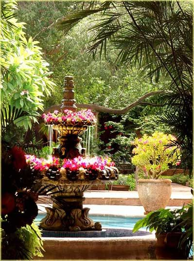 Beautiful Stone Fountain Full Of Pink Flowers!