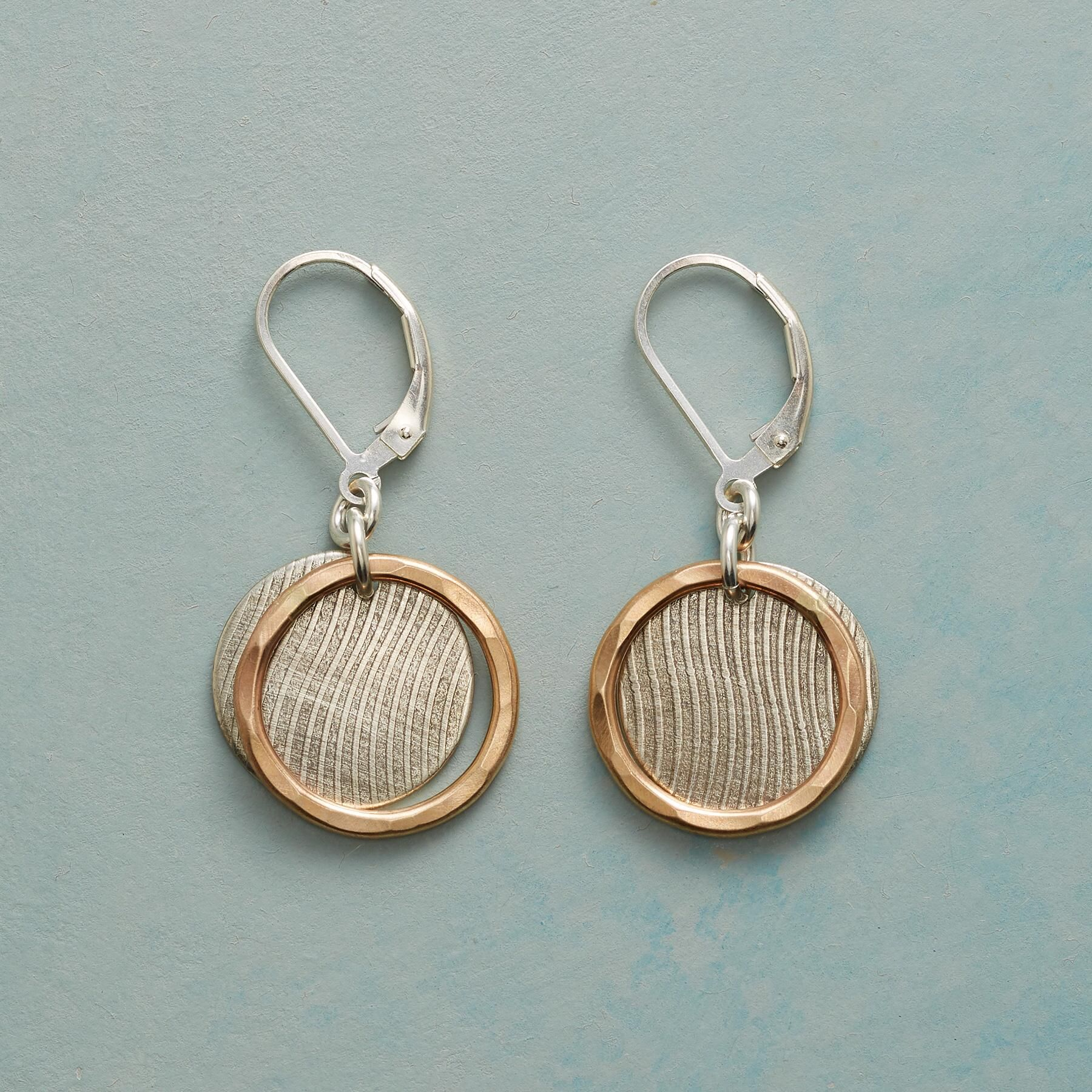 GOLDEN LINING EARRINGS -- The windswept sterling silver disks of our ...