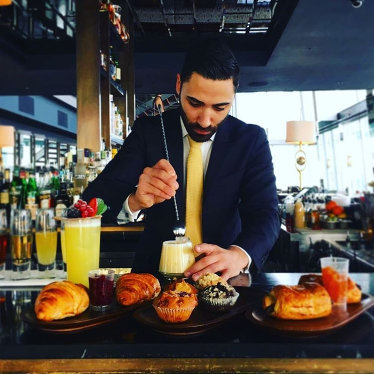 aquashard bar manager Luca mixing up his special creations for - bar manager