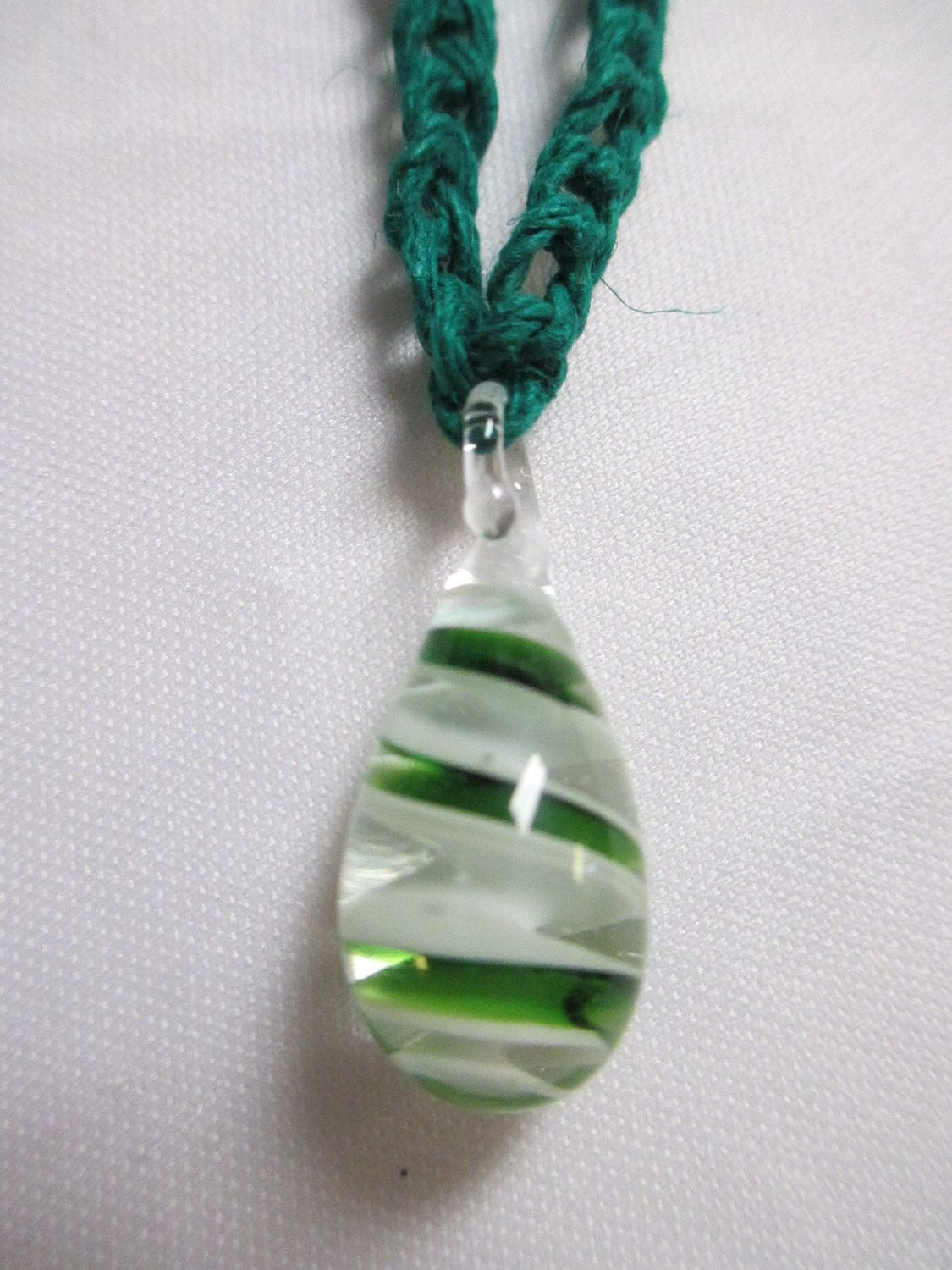 A personal favorite from my Etsy shop https://www.etsy.com/listing/193662119/green-swirl-hemp-necklace-glass-pendant