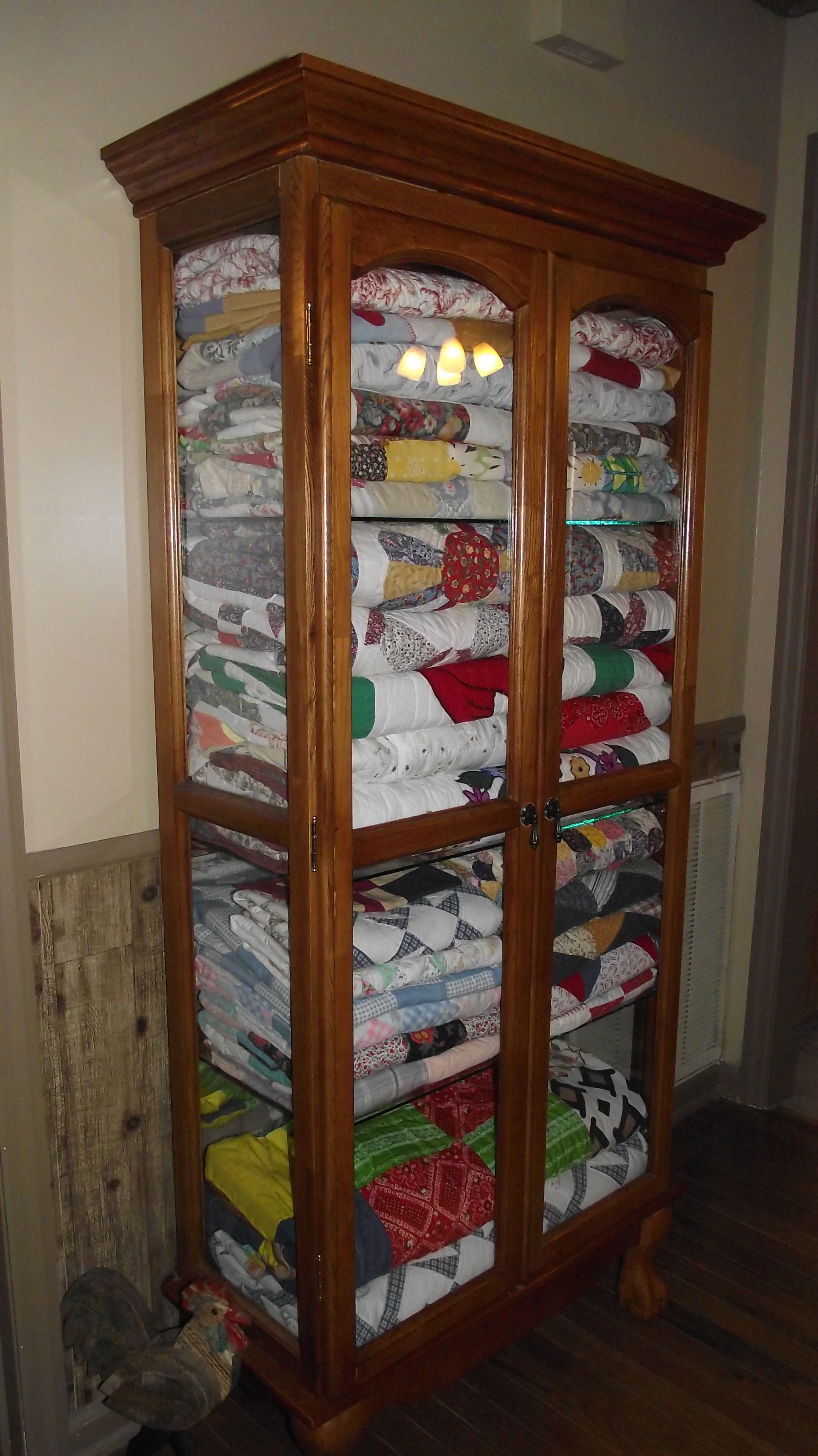Keep Quilts Tidy And Dust Free In Curio Cabinet Surrounded