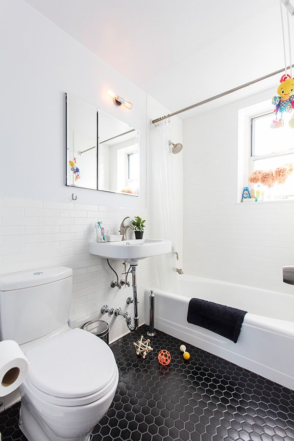 Clean And Bright Bathroom Renovation Features Black, Hex Floor Tiles, White  Ceramic Subway Tiles, A Slim Toto Toilet, And Wall Mounted Porcelain Sink  With ...