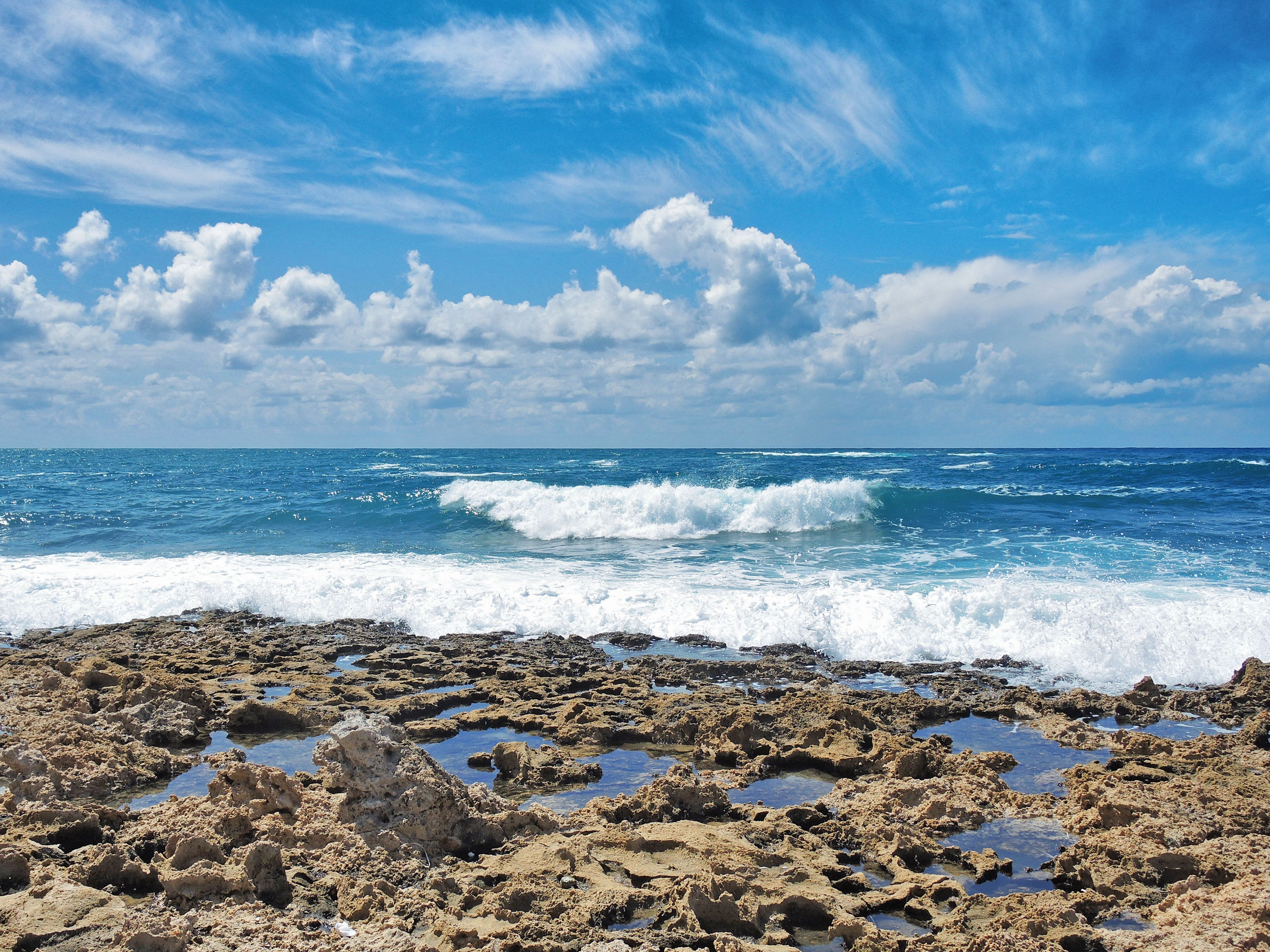 Sunny day at the beach waves sea rocks and a blue cloudy - Sunny day wallpaper ...