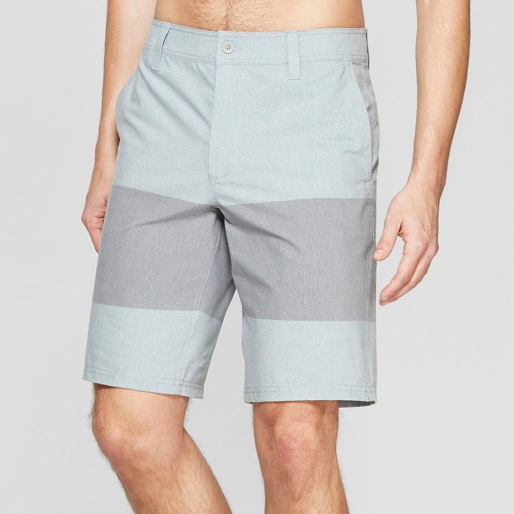 7cf26da0dc Bring comfortable style to your swim look with these men's Striped Hybrid  Swim Shorts from Goodfellow and Co. Featuring a gray background with a  solid ...