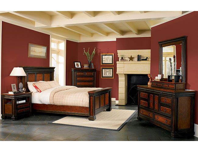 Dark Maroon wall paint in a bedroom with black laminated floor and